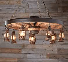 a reion wagon wheel and seven hanging lanterns the large wagon wheel chandelier with rustic lanterns is perfectly suited to your old west home