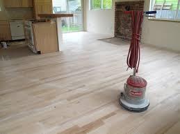 diy reclaimed wood flooring sanded and sealer coating the owner