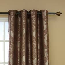traditional room darkening curtains in brown with fl pattern and black rods on cream wall for
