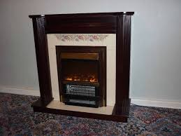 tiled fireplace with dark wood surround flame effect electric 3 bar fire