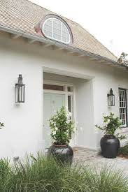 Coastal Living Ultimate Beach House in Rosemary Beach. Color scheme, stucco,  planters.