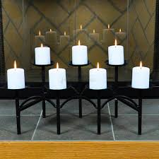 awesome black fireplace candelabra made of iron with seven candle for heat warming room decor ideas