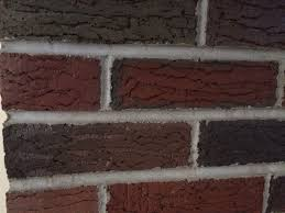 close up of bricks before paint treatment