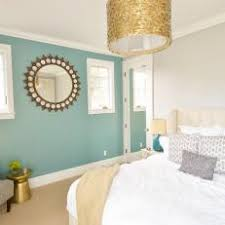 Transitional Bedroom With Turquoise Accent Wall