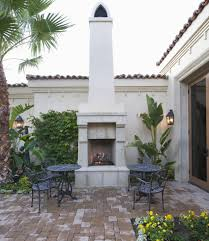 white outdoor fireplace with tall chimney