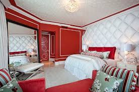 red wall paint black bed:  luxurious bedroom embraces hollywood regency style at its chic best