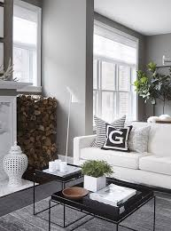 white sofa with black tray coffee tables