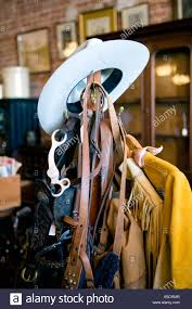 Cowboy Coat Rack Western tack and a cowboy hat on a coat rack Stock Photo 100 30
