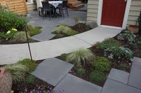 Concrete Path Designs Concrete Path Divides A Small Yard With Two Seating Areas