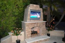 image of outdoor fireplace with tv