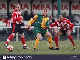Pat Harding of Horsham shields the ball from Jonathan Spencer of Stock  Photo - Alamy