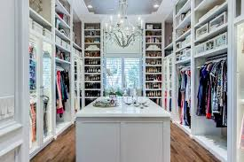 walk in closet window seat flanked by shoe shelves