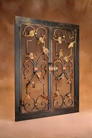 leaf and scroll fireplace screen with bronze and gold coloring made by the artisan blacksmiths