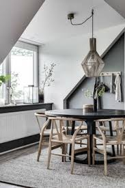 amazing dining room design with round black table pendant light and wishbone chairs
