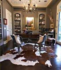 Driven By Dcor: Cowhides Layered Over Natural Fiber Rugs