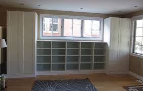 Premade Built In Bookcases Diy Built Ins Using Ikea Besta Shelves And Pax Wardrobes