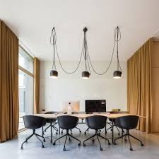 interior designer for office. curtains separate spaces of lisbon office for a interior designer