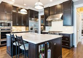 contemporary kitchen with dark wood cabinets and white calacatta marble countertops