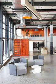retro office design. In The Office Above (right), Some Extra Space Has Been Turned Into Informal Reading Spots, Including Black Retro Desk Lamps For Light. Design