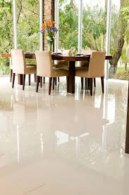 white porcelain tile floor. White Porcelain Tile Flooring In Modern Dining Room Interior Design Under Cream Fabric Chairs Facing Large Wooden Table Floor