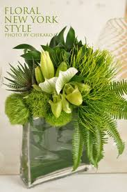 Amazing green floral arrangement of slipper orchids. and foliage by FLORAL  NEW YORK, via Arrangement