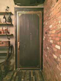 these standard steel doors were transformed with just paint to look like old vine steel bank vault doors for a local indianapolis hotel