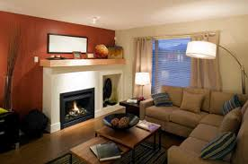 condo livingroom modern charming appropriate accent wall paint ideas red and white matching colors in condo living room home ideas with arched lamp also l