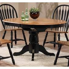 single pedestal dining table in deep rustic oak and black nebraska furniture mart kitchen