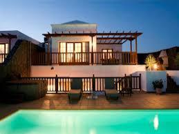 Luxury backyard pool designs Luxurious Pool Luxury Backyard Pool Design Featuring Wooden Balcony Railings New Life Outdoors Pool Luxury Backyard Pool Design Featuring Wooden Balcony Railings