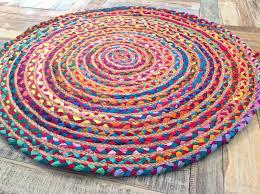 round braided multi coloured fabric jute rug