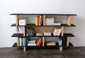 i love the look of this home library it appears super simple to build basically she used wood supports for the shelves and then placed the shelving