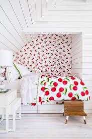 A very retro vibe in this bedroom, personally I love the Cherry Duvet  Cover, but I don't like the wallpaper. I would pick out either the red from  the duvet ...