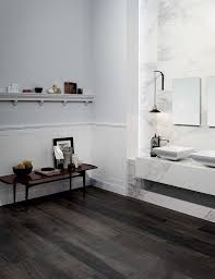 point it out with a contrast dark wood effect floor and you have a unique bathroom style wooden tile of casa dolce casa