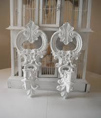 white wall sconces ornate candle holders shabby chic wall