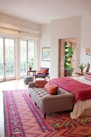 Pink Rugs For Living Room Cute Living Room With Pink Tribal Bohemian Rug Under Tan Tufted