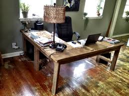 L-shaped desk that I built out of salvaged floor boards from an old shotgun