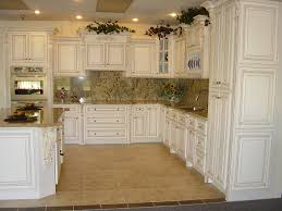 antique white kitchen cabinets using traditional design made from wooden material and beige marble countertop ideas