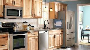 hickory kitchen cabinets with black countertops black granite