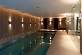 indoor swimming pool lighting. Textured Tree Bark Wall Finish Along Indoor Swimming Pool Contemporary- Swimming-pool Lighting N