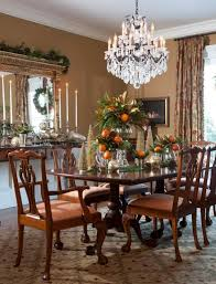 sparkling crystal chandelier for traditional dining room ideas with carved wooden chairs and ornate glass table