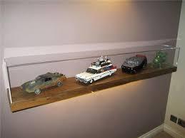 acrylic display cases on wall mounted floating shelf
