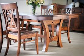 this magnificent solid maple dining table with two leaf extensions expertly crafted by indiana amish builders this beautiful table and chair set is