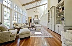 living room with cathedral ceiling traditional hardwood floors on oyster shell chandelier