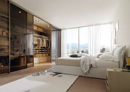 bedroom walk in closet behind bed contemporary furniture