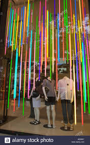 creative lighting displays for by colorful window display in a clothing with three