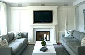 stone fireplace with above built ins cabinets and faux stand