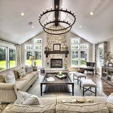 living room dreams living room goals accent chandelier a frame ceiling stone fire place mantle oversized coffee table oversized couch