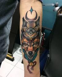 татуировка тотема совы и лисы на предплечье парня фото рисунки