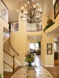 small foyer lighting. Foyer Lighting Ideas With Chandelier And Round Glass Table Laminate Flooring Small
