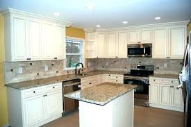 ivory kitchen cabinets. Ivory Kitchen Cabinets With Dark Black Countertops Crafted Cabinet A